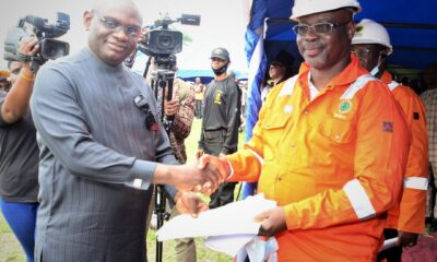 Pix Caption: Convener and leader of the Ogoni Liberation Initiative, Rev. Douglas Fabeke (left), presenting a communique from the Ogoni leaders to the Managing Director, Nigerian Petroleum Development Company (NPDC), Mr. Mohammed Ali-Zarah, who was invited as guest to the Ogoni Liberation Day celebration which held in Bori, Rivers State... Tuesday.